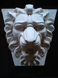 Маскарон лев